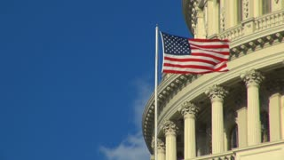 American Flag on Capitol Building Blowing in the Wind
