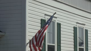 American Flag on Outside of House Waving