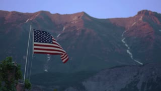 American Flag Waving in Front of Mountain