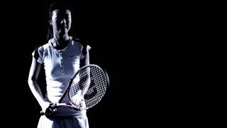 An Asian woman plays tennis against a black background.