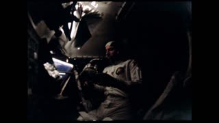 Apollo 12 Astronaut Using Tools