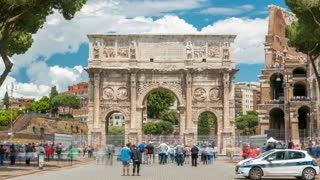 Arch of Constantine timelapse, Rome, Italy. Built to commemorate the emperor's victory over his rival Maxentius in AD 312. Located near colosseum. Blue cloudy sky and crowd around