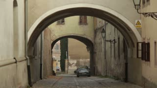 Archways Over Cobblestone Street
