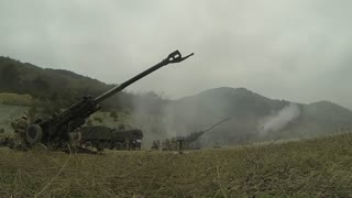 Artillery gun line firing for effect at SSang Yong 2014