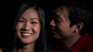 Asian Couple Kissing on Cheek 2
