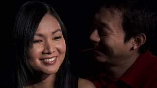 Asian Couple Kissing on Cheek
