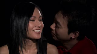 Asian Couple Kissing on Neck 2