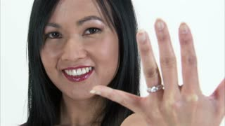 Asian Girl Showing Off Diamond Engagement Ring with Rack Focus