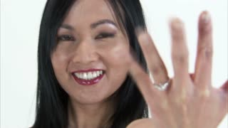 Asian Girl Showing Off Diamond Engagement Ring