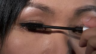 Asian Woman Putting on Mascara 2