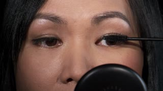 Asian Woman Putting on Mascara 3