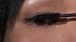 Asian Woman Putting on Mascara 4