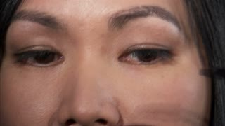 Asian Woman Putting on Mascara