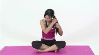 Asian Woman Sitting on Pink Yoga Mat