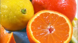 Assorted Citrus Fruit Rotating on White Background 2