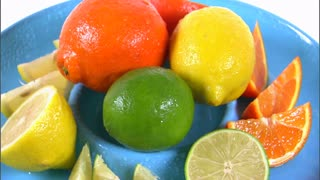 Assorted Citrus Fruit Rotating on White Background 4