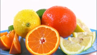 Assorted Citrus Fruit Rotating on White Background 5