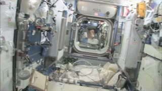 Astronaut Bicycling in Space Station