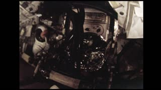 Astronaut in Spacesuit Moving Around Spacecraft