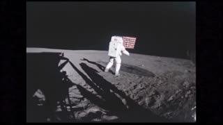 Astronaut Next to American Flag