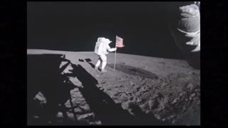 Astronaut Planting Waving American Flag