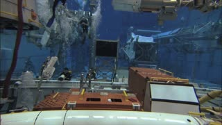 Astronaut Practicing With Instruments Underwater