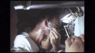 Astronaut Shaving in Command Module
