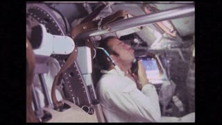 Astronaut Using Electric Razor in Module