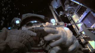 Astronaut Using Tools To Repair Module Underwater 2