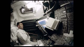 Astronaut Working Control Panel in Apollo 12