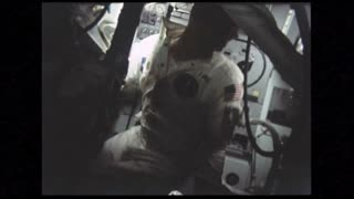 Astronauts Floating in Command Module