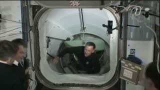 Astronauts Hugging Inside Space Station