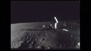 Astronauts On Moon Surface Adjusting Equipment