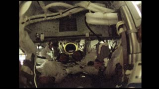 Astronauts Passing Tools in Zero Gravity