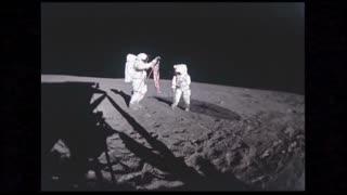 Astronauts Planting American Flag