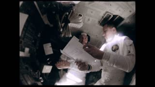 Astronauts Reading Manual in Apollo 12 2