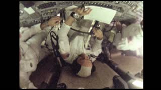 Astronauts Working on Apollo 10 Control Panel