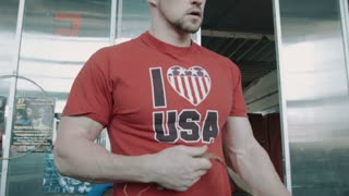 Athlete bodybuilder fixes barbell om  the bar in gym movement shot
