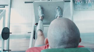 Athlete runner or sprinter does workout for legs on on leg press machine. Preparate for olympic competition. Movement shot