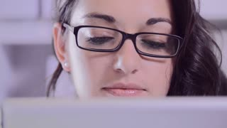 attractive brunette business woman working on tablet computer