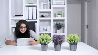 attractive modern business woman in home office using tablet computer
