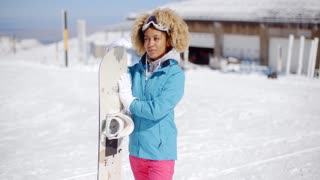 Attractive young woman posing at a ski resort