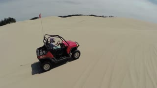 ATV Driving on Sand Landscape Aerial
