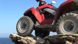 ATV on Rocks Near Ocean 2