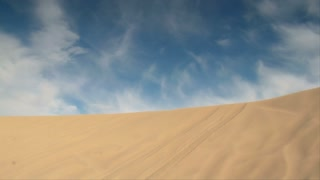 Atv Rider Jumps Sand Dune In Slow-motion