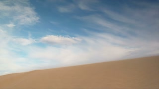 Atv Rider Jumps Sand Dune Slow-motion
