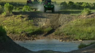 Atv Riders Cross Stream