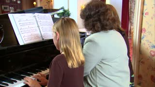 Aunt and Nieces Playing Piano 3