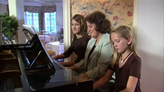 Aunt and Nieces Playing Piano 8