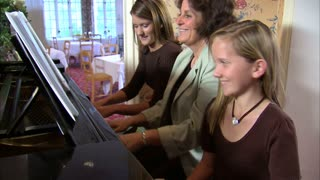 Aunt and Nieces Playing Piano